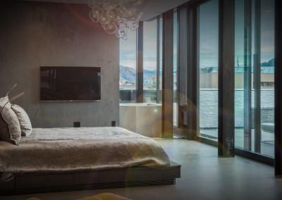 Master bedroom with glass doors to balcony.