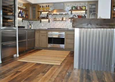 Nice modern kitchen with tin trim and open wooden shelves.