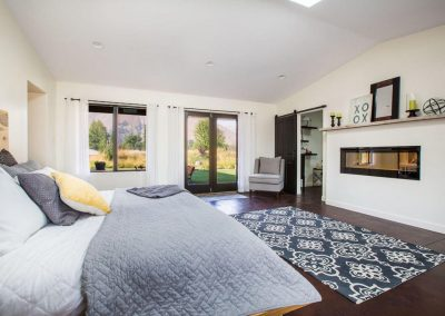 Master bedroom with stained radiant concrete floors and french doors.nt con