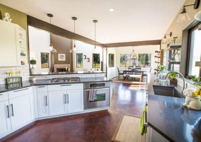 Modern Farmstyle kitchen with open floor plan and dining room nook.